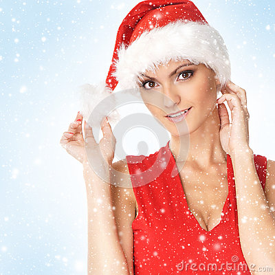 Portrait of a young woman in a red Santa hat