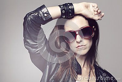 Portrait of a young woman with a rock look Stock Photo