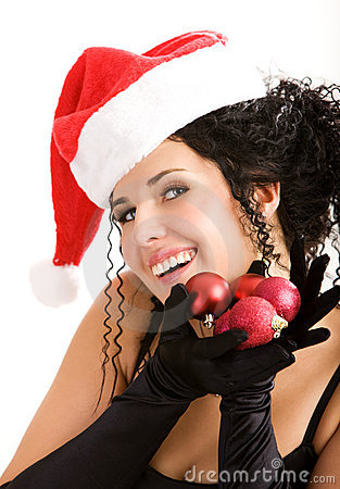 Portrait of the young woman in Santa s hat