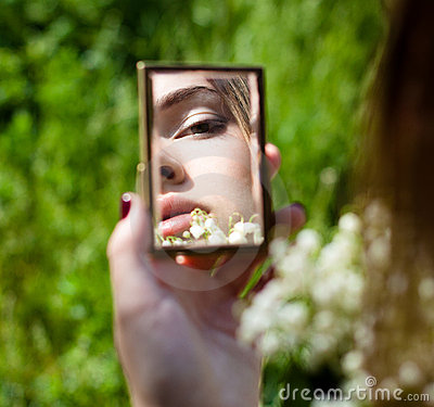 Portrait of Young Woman in Small Mirror