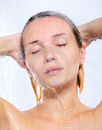 Portrait of young woman taking shower