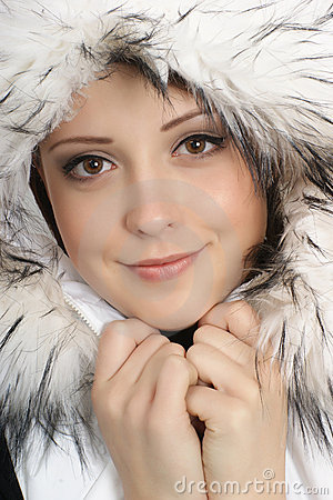 Portrait of a young woman in a warm winter dress