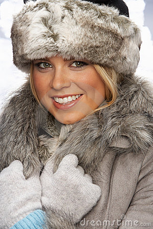 Portrait Of Young Woman Wearing Fur Hat And Coat