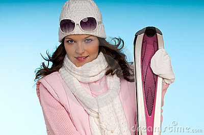 Portrait of young woman wearing skiing clothes