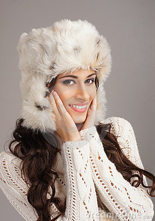 Portrait of a young woman in a winter hat