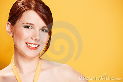 Portrait of young woman on yellow background