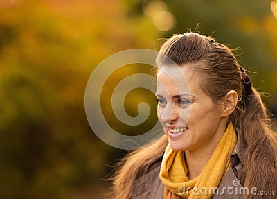 Portraits of happy young woman outdoors