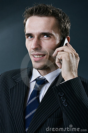 Portraiture of young handsome businessman taking