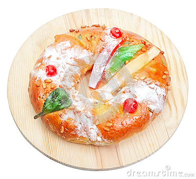 Portuguese king cake on a wooden stand.