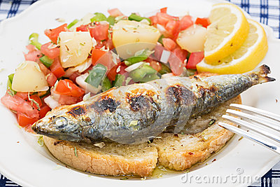 Portuguese Style Grilled Sardines With Salad Stock Photo - Image ...