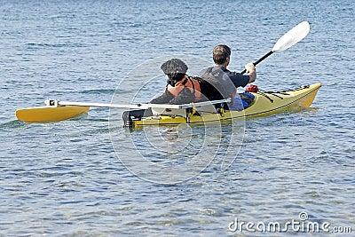Portuguese Water Dog on Yellow Kayak