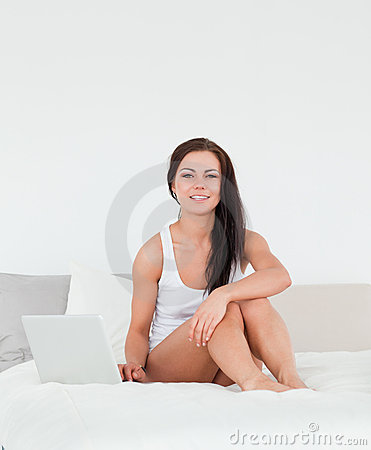Posing brunette with a laptop