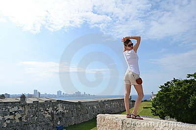 She is posing at a fortress