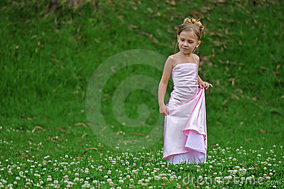 Posing girl in pink dress