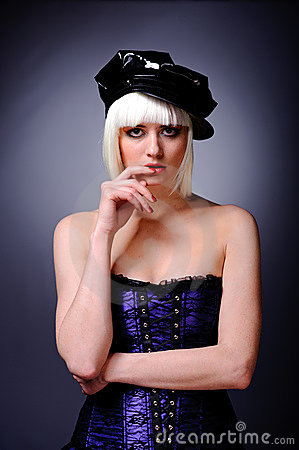 Posing model with blonde hair and black peaked cap