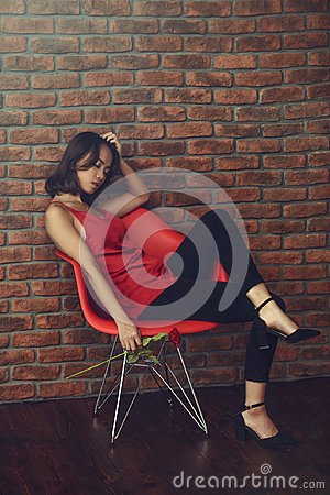 Free Posing On Red Armchair Royalty Free Stock Image - 104354896