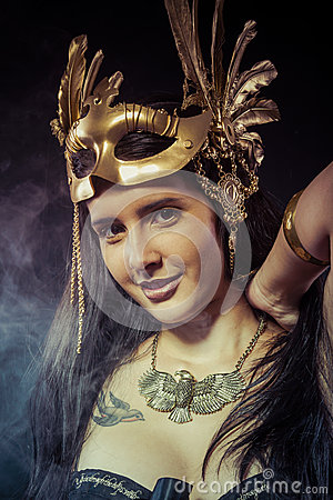 Free Posing Warrior Woman With Gold Mask, Long Hair Brunette. Long Ha Stock Images - 36294054