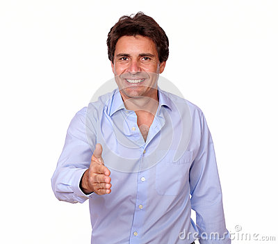 Positive adult man greeting you with his hand