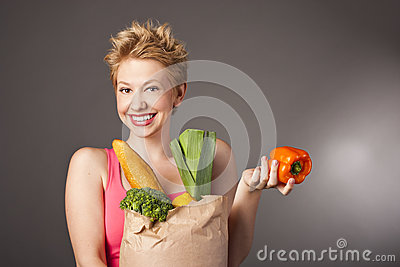 Positive attractive girl with useful food