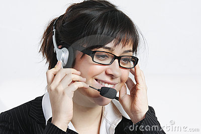 Positive brunette businesswoman with headset