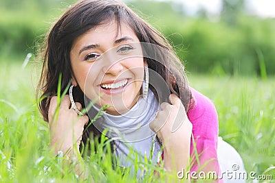Positive brunette in grass