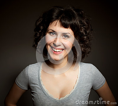 Positive  brunette  woman  with  curly haircut