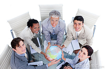 Positive business people holding a globe