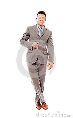 Positive businessman with legs crossed