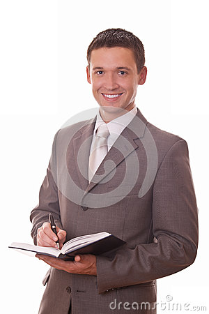 Positive businessman with notepad