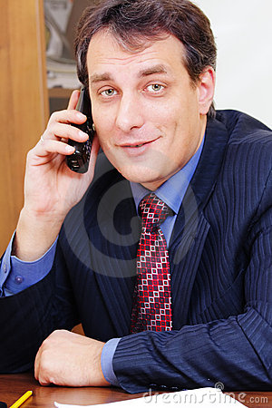 Positive businessman on phone