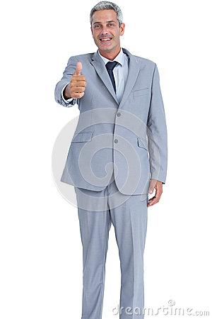 Positive businessman showing thumb up
