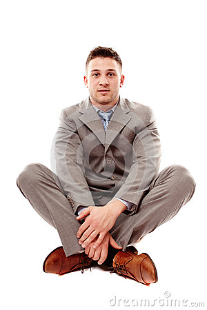 Positive businessman sitting cross legged