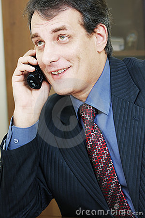 Positive businessman talking via phone