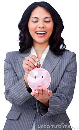Positive businesswoman saving money in a piggybank