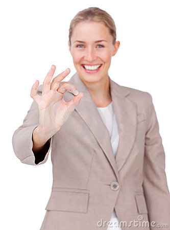Positive businesswoman showing OK sign