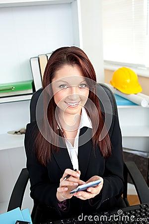 Positive businesswoman using her calculator