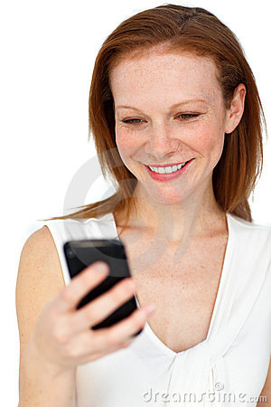 Positive businesswoman using a mobile phone