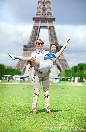 Positive couple having fun near the Eiffel towe