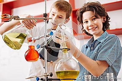 Positive curious boys visiting a scientific club
