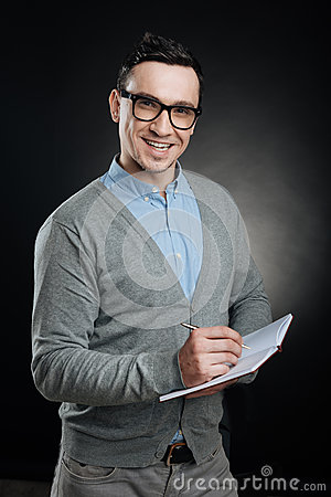 Free Positive Delighted Man Holding Notebook In Left Hand Royalty Free Stock Photos - 88941968