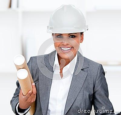Positive female architect holding blueprints