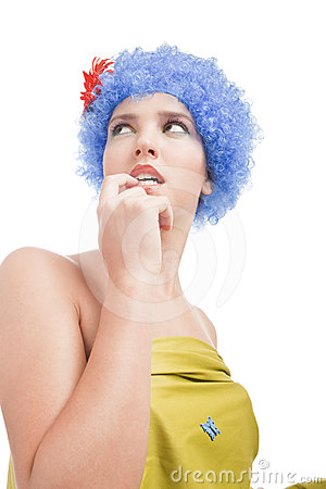 Positive girl with blue hair looks up