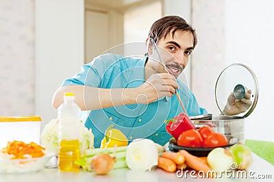 Positive guy doing vegetarian lunch