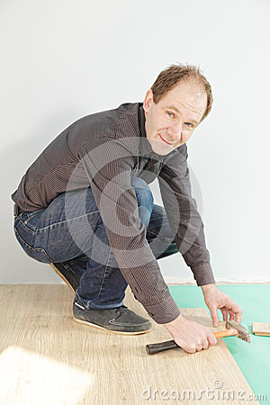 Positive guy installing flooring