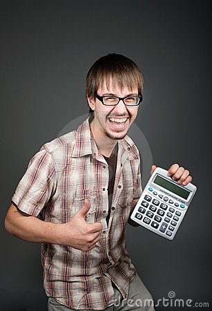 Positive man with calculator on grey