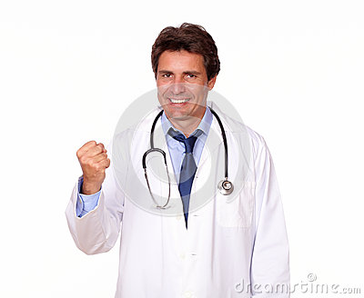 Positive medical doctor standing in white uniform