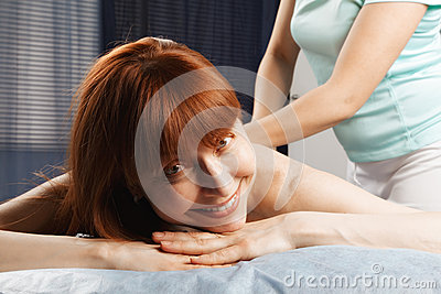 Positive redhead having a massage