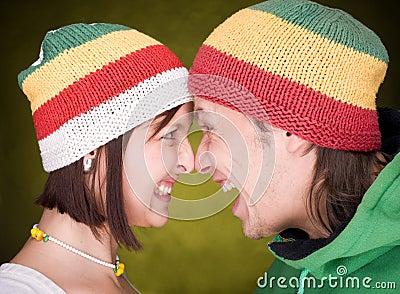 Positive pair in reggae hats that  scream