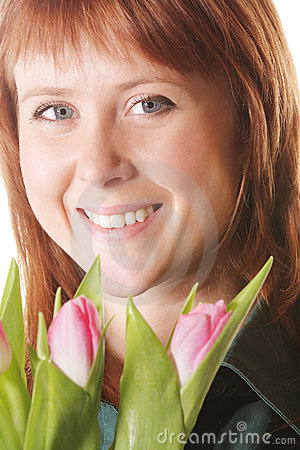 Positive redhead with pink tulips