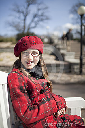 Positive school age girl is in the park